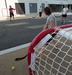 Gina Kingsbury makes a save on a shot from Jason Myslicki while playing road hockey with Annie Moniqui and Marie-Eve Beauchemin-Nadeau at the Canadian residence in the Olympic Village!