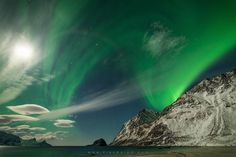 Aurora Wave... Amazing Aurora patterns over Mount Veggen, on a full moon night in Haukland beach by Erez Marom on 500px.