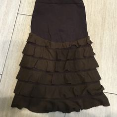 Maternity brown skirt with tired ruffles Let's just say there are a few things that honestly if they weren't maternity I would want to keep this is one of my favorite skirts of all times. Haha but I need to let go of maternity I should not be wearing maternity clothes. Ugg this makes me sad but such is life. The tag says medium this would definitely fit a small maybe even an extra small it's very stretchy there is a lining underneath the tiers! Best skirt ever!!! Motherhood Maternity Skirts…