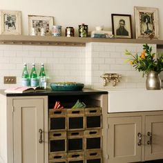 Shaker kitchen, vintage black and white photos in old frames