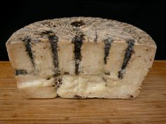 A black truffle paste is injected into Pecorino Moliterno al Tartufo after some aging has taken place, giving the raw sheep's milk cheese a striking appearance.