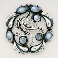 Moonstone and Sterling Silver Brooch, Georg Jensen (1930s-1940s) - width 1 3/4 ins, height 1 7/8 ins - Sold for $1,200 Canadian in Fall 2011 to one lucky lady. Gorgeous brooch. Circa 1930s-1940s. Lot 489.