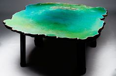'Six Tables on Water' by Gaetano Pesce. Beautiful resin tables each sculpted to look like a different body of water: an ocean, a lagoon, a river, a lake, a pond, and a puddle.