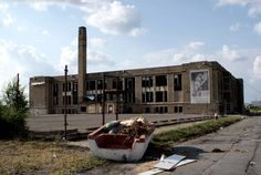Abandoned school with parking lot boat.