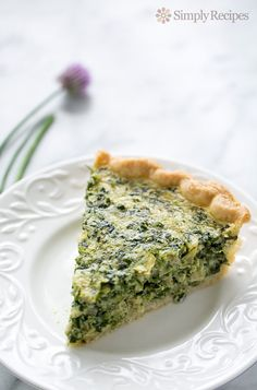 Spinach and artichoke quiche! With chopped spinach and artichokes hearts, shallots, goat cheese, green onions, eggs, and cream. Perfect for a Sunday brunch! On SimplyRecipes.com #Artichoke #Quiche #Spinach #BrunchRecipes