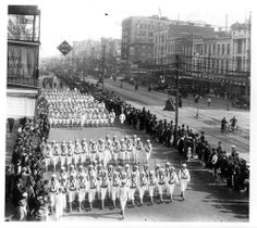 Parade of sailors marching down Canal Street during World War One