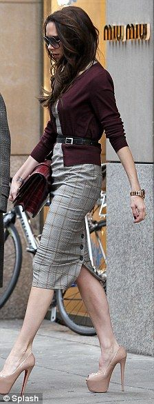 Vicky B - give me this entire outfit!! love the buttons by the dress slit. and cranberry cardigan. and loubs.