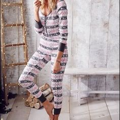 Victoria's Secret fireside onesie pajamas Brand new!! Bought for my sister for Christmas but they're too big and they're out of stock now so she's getting something different. Get into a snowed-in state of mind with this cozy cotton PJ that pairs a long-sleeve top with satin trim and a comfy legging. Slim fit Soft cotton Long-sleeve top hits at hip, with satin button placket and satin trim Legging with ribbed elastic waist Contrast ribbed cuffs can be folded to alter length Imported…