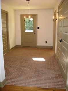Lancaster Running Bond brick tile floor, Old Strasburg color mix, with mortar left in some of the texture.