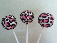leopard, zebra, and pink cake pops! - i made these just for fun. My mom took them with her to work and i already have people wanting some! i've been wanting to try the leopard pops for a while now. WARNING! they took forever to do! same with the zebra pops! but it was fun :)
