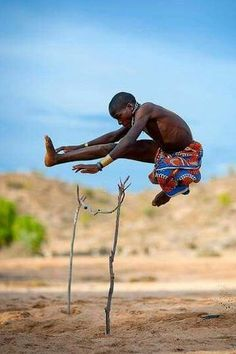 High Jumping by a Mukubal kid from Angola photo By Eric Lafforgue African Culture, African Art, African Tribes, People Around The World, Around The Worlds, Africa People, Eric Lafforgue, Out Of Africa, High Jump