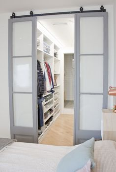 The walk-in closet which leads to the ensuite bathroom was designed by Abel Perez. He found these sliding doors for each from an app called Wallapop, which sells all things second hand. He had them repainted, giving them a new polished look. Walk In Closet Design, Bedroom Closet Design, Master Bedroom Closet, Closet Designs, Bathroom Interior Design, Home Bedroom, Bedroom Decor, Master Bedroom Plans, Bedroom With Ensuite
