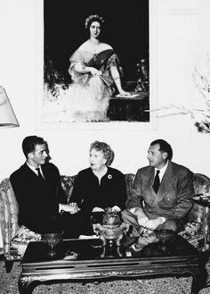 King Juan Carlos I, Queen Victoria Eugenia and Infante Juan, Count of Barcelona sitting under a portrait of Queen Victoria