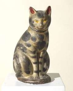 "Olde Hope Antiques, Inc. Chalkware Cat. c. 1860. Original polychromed and ""smoked"" decoration. 15"" high."