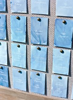 How lovely are these blue, hand-painted escort cards? They were displayed on a linen board at this airy wedding.