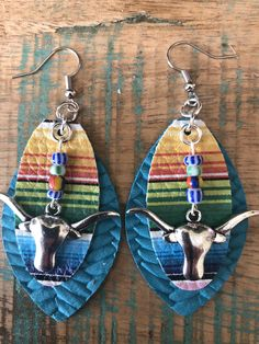 Excited to share this item from my shop: Longhorn Turquoise Braided Genuine Leather earrings, serape, steer head, western, cowgirl earrings Cute Jewelry, Body Jewelry, Jewelry Crafts, Geek Jewelry, Metal Jewelry, Jewlery, Jewelry Necklaces, Cowgirl Jewelry, Western Jewelry
