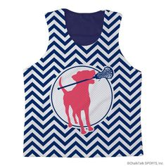 ChalkTalkSPORTS Girls Lacrosse Racerback Pinnie Lacrosse Dog with Girl Stick and Chevron - Navy Interior. 100% polyester. Pick, pull, pill resistant. Moisture and odor management fabric. Each pinnie is made to order - slight variations may occur due to material and process and there may be small amount of white mesh in the seams of the pinnie. Official ChalkTalkSPORTS Brand Product - Passionate about sports and the products we make.