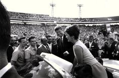 Jacqueline Kennedy and her husband John F. Kennedy attend the Orange Bowl in Miami, FL January 29, 1962 where JFK addressed the 2506th Brigade after the Bay of Pigs. (Kennedy Library Archives, Getty Images).