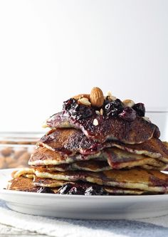Start your day with these delicious blueberry almond pancakes, topped with homemade honey poached blueberries. Perfect for breakfast!