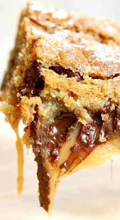 Gooey Salted Caramel Chocolate Chip Cookie Bars ~ They're ooey and gooey and everything you'd ever want in a dessert... Crazy delicious!