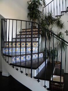 Tiled stair risers pump up the color on this black and white staircase