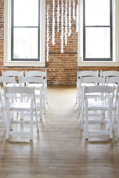 emmalinebride.com - real weddings.  Ck out this space (alot like yours) and I love the white/pastel flowers on white linens.