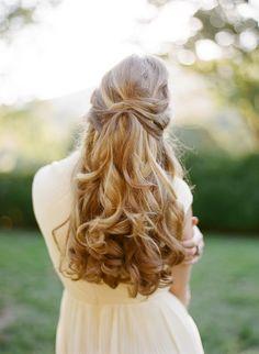 Elegant and romantic long hairstyle. Hair by Lora Kelley. Image credit: Eric Kelley via Once Wed.