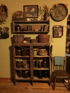 Primitive cupboard with crocks and buckets...