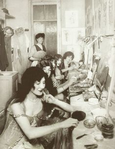 Inside a dressing room at the Moulin Rouge, c.1915.