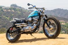 Hollywood Harley: A Sportster 883 Dirt Tracker Is it possible to turn a Harley-Davidson Sportster 883 into a capable dirt tracker? Hollywood-based builder Clint Hanaway proves the answer is Yes. Harley Davidson Sportster 883, Hd Sportster, Harley Davidson Street Glide, Harley Davidson Motorcycles, Custom Motorcycles, Custom Bikes, Sportster Parts, Moto Scrambler, Bobber Custom