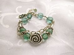 sterling wirework and recycled beach glass, hill tribe silver charm bracelet