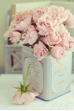 Centerpieces. I love the idea of old tea tins with flowers.