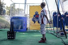 Camp Honda at the 2013 Little League® Baseball World Series.    Got him! This fan hit the target, and dunked his friend.
