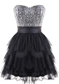 Maybe a dress similar to this with those silver/white feather heels from my calendar?