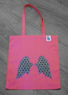 Check out this item in my Etsy shop https://www.etsy.com/listing/228859847/pink-cotton-bag-with-appliqued-wings