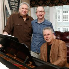 Left to right. Harvey Feinstein, jake Feldman , and Alan menken. Best song and film writers EVER!