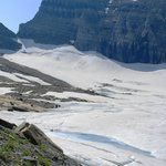 The glacier peaking out from under the snow