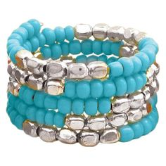 Coil ring with silver-hued metal and turquoise beads.   Product: RingConstruction Material: Metal and beads...