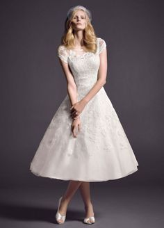 Well, tea length wedding dresses are when the skirt of the dress is only up to your medium of your ankle or half of calves.