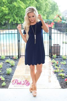 This bestselling dress will make you wish springtime was forever! The navy color paired with the scalloped details on the sleeves and bottom hemline is so soft and feminine, while the lightweight material is great for warm spring and summer days.