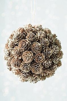 SO doing this. Styrofome ball, hot glue pine cones, attach ribbon for hanging. So cute!