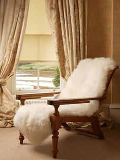 Ok I googled this image and this was the best I could find... I found a desk chair (on a blog) that was covered with a sheepskin and I fell in love.  Soooo comfy!!