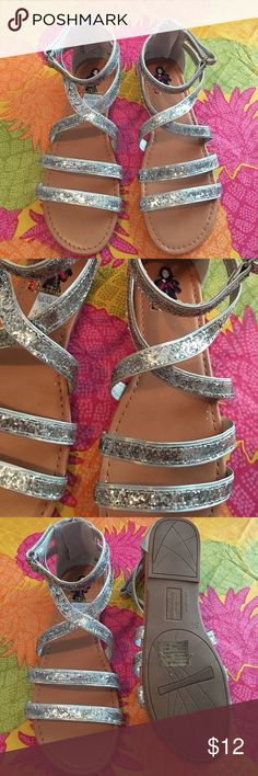 Disney Descendants Sandals Cute silver glittery sandals in a girls 5.5 equivalent to a women's size 7.5. Brand new in box. Disney Shoes Sandals & Flip Flops