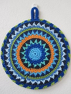 Anne Paal Its potholders. I love the vivid waves of colors!