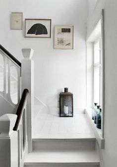 love the white floors and the newel post