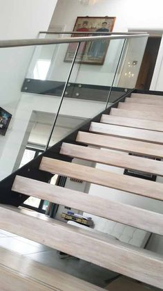 This straight-flight Model 500 staircase comes with steel stringers and white wax oak treads. You can see more pictures of this staircase and read more on this project by clicking the link above.