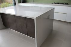 Cosentino Silestone Grey / Silver Aluminio Nube Waterfall Island and worktops. Installed in Wimbledon, London.