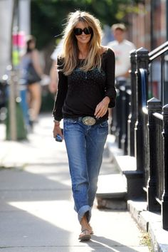 Elle-Macpherson-1921-jeans rolled up... have many belts like this, but a white loose t-shirt or black button up is a better look with such a statement belt..IMHO
