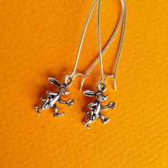 $7.00.  TINY RUNNING BUNNIES earrings are ADORABLE!!  Doesn't everyone need these in their ears?!  :)