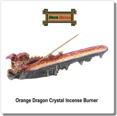 Orange Dragon Crystal Incense Burner - This orange dragon will bring dramatic style to your space as your favorite incense fills your room with aroma. This cool incense burner is made from polyresin with an orange dragon head watching over a long geode filled with orange crystals. Just add incense!
